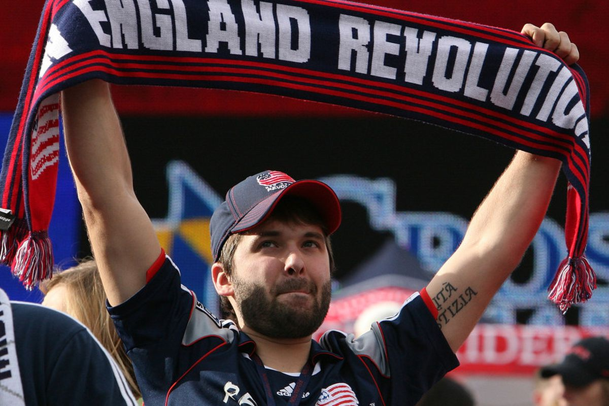 FOXBORO, MA - APRIL 14:  A fan of the New England Revolution holds up a banner during a game against the DC United at Gillette Stadium April 14, 2012 in Foxboro, Massachusetts. (Photo by Gail Oskin/Getty Images)