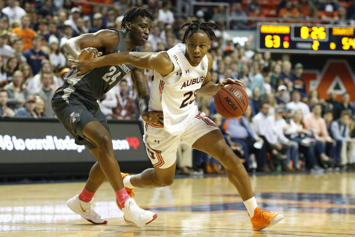 Auburn Tigers forward Isaac Okoro is pressured by Iowa State Cyclones guard Terrence Lewis during the second half at Auburn Arena.