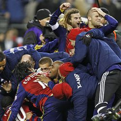 RSL team members pile on top of each other celebrating a win in MSL Cup 2009.