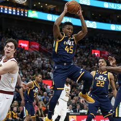 Utah Jazz guard Donovan Mitchell (45) pulls in a rebound during the game against the Cleveland Cavaliers at Vivint Arena in Salt Lake City on Saturday, Dec. 30, 2017.