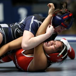 Brooklyn Pace of Copper Hills takes down Arleth Antonio of Granger wrestle in class 115 as girls compete for the 6A State Wrestling championship at West Lake High in Saratoga Springs on Monday, Feb. 15, 2021.