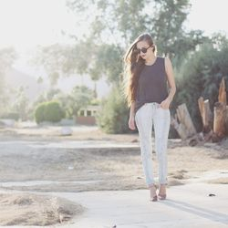 Bethany models another look: a top, jeans, sunglasses and shoes from Lulu's.