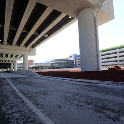 A new roadway at the Salt Lake City International Airport is pictured on Thursday, Aug. 15, 2019. Starting early Friday morning, drivers leaving the airport will take a detour to Terminal Drive that will take them past the new parking garage and the new central terminal, which are still under construction.
