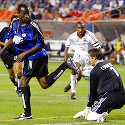 Real Salt Lake goalie D.J. Countess, right, blocks a backward kick from Colorado's Jean Philippe Peguero during the first half Wednesday.