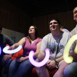 University of Utah grad students, from left to right: Kurt Coppersmith, Laura Warner, Wade Paterson, and Brandon Davies play the video game that they developed for Primary Children's Medical Center patients in Salt Lake City  Tuesday, Aug. 23, 2011.