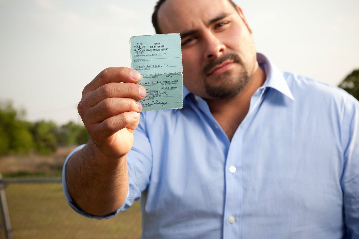 Frank Rodriguez, showing his sex offender card, was convicted of statutory  rape when he