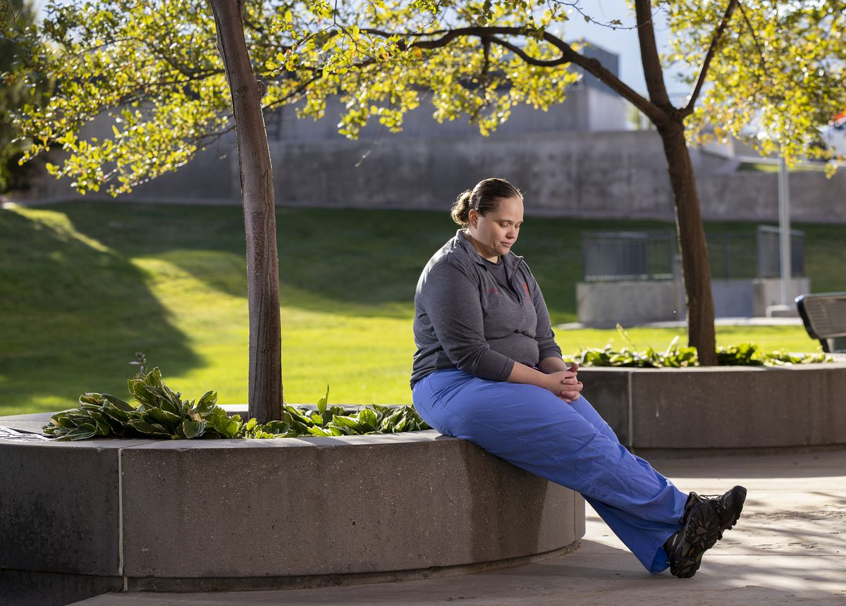 Lori Green, a respiratory therapist at University of Utah Health who works with COVID-19 patients, poses for photos outside of the University of Utah Hospital in Salt Lake City on Friday.