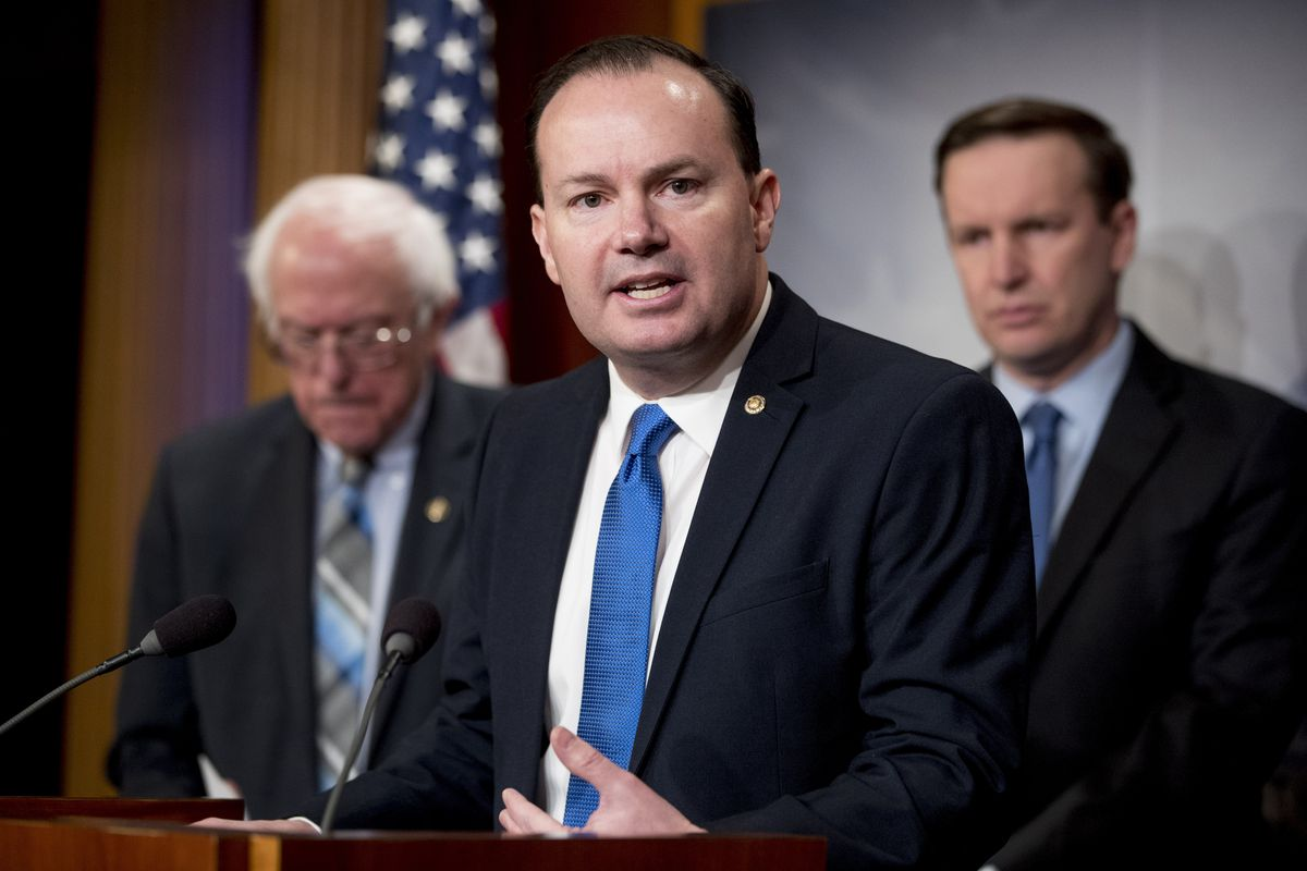 Sen. Mike Lee, R-Utah, accompanied by Sen. Bernie Sanders, I-Vt., left, and Sen. Chris Murphy, D-Conn., right, speaks at a news conference on Capitol Hill in Washington, Wednesday, Jan. 30, 2019, on a reintroduction of a resolution to end U.S. support for the Saudi-led war in Yemen. (AP Photo/Andrew Harnik)