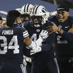 Brigham Young Cougars defensive back Jared Kapisi (43) celebrates his interception against the Texas State Bobcats in Provo on Saturday, Oct. 24, 2020.