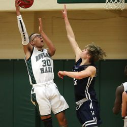 Rowland Hall's Isaiah Adams puts in a shot over Waterford's Sam Becker as they play at Rowland Hall in Salt Lake City on Wednesday, Jan. 15, 2020.