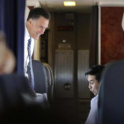 Republican presidential candidate and former Massachusetts Gov. Mitt Romney is seen with Policy Director Lanhee Chen on their campaign plane as it flies to Salt Lake City, Utah, Tuesday, Sept. 18, 2012.