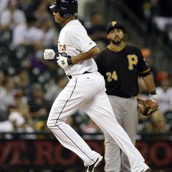 Houston Astros' Justin Maxwell, left, runs past Pittsburgh Pirates third baseman Pedro Alvarez (24) after hitting a home run during the sixth inning of a baseball game on Friday, Sept. 21, 2012, in Houston.
