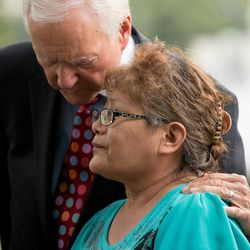 Sen. Orrin Hatch, R-Utah, left, comforts Utah resident and Navajo Susie Philemon as she becomes emotional while expressing her opposition to a proposed national monument in the Bears Ears region in southeast Utah on Wednesday, Sept. 21, 2016. Philemon spoke on Capitol Hill in Washington, D.C.