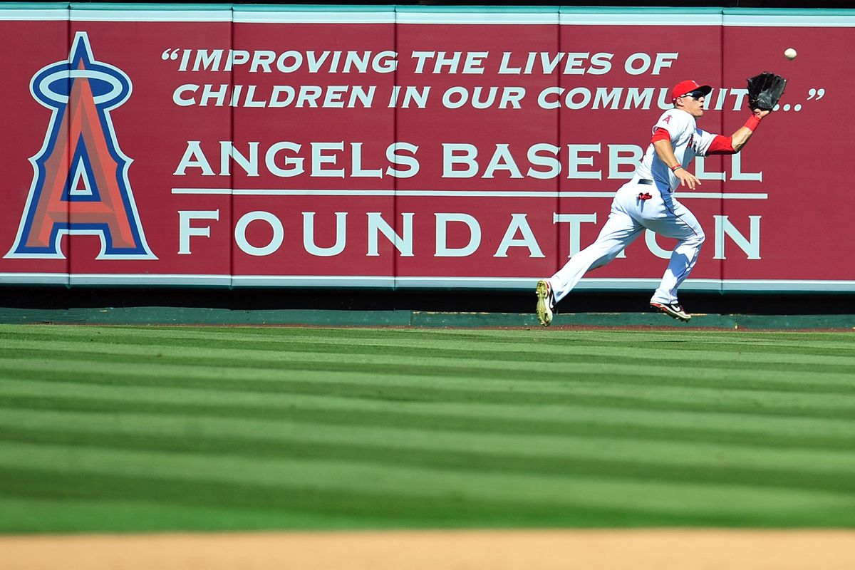 August 12, 2012; Anaheim, CA, USA; Los Angeles Angels center fielder Mike Trout (27) catches a fly ball in the eighth inning against the Seattle Mariners at Angel Stadium. Mandatory Credit: Gary A. Vasquez-US PRESSWIRE