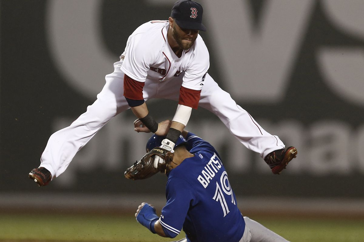 Pedroia leaping over Bautista