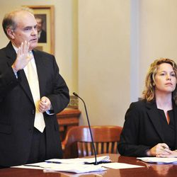 James Layton, Missouri solicitor general and the state of Missouri's principal appellate lawyer, speaks on behalf of Secretary of State, Robin Carnahan, in the the lawsuit challenging/questioning Secretary of State Carnahan's ballot language for Amendment 3 on the Nov. 6 general election ballot. Seated at right is attorney Heidi Doerhoff Vollet.