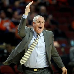 BYU head coach Dave Rose reacts to a call during the first half of an NCAA college basketball game against Illinois, Saturday, Dec. 17, 2016, in Chicago. (AP Photo/Nam Y. Huh)