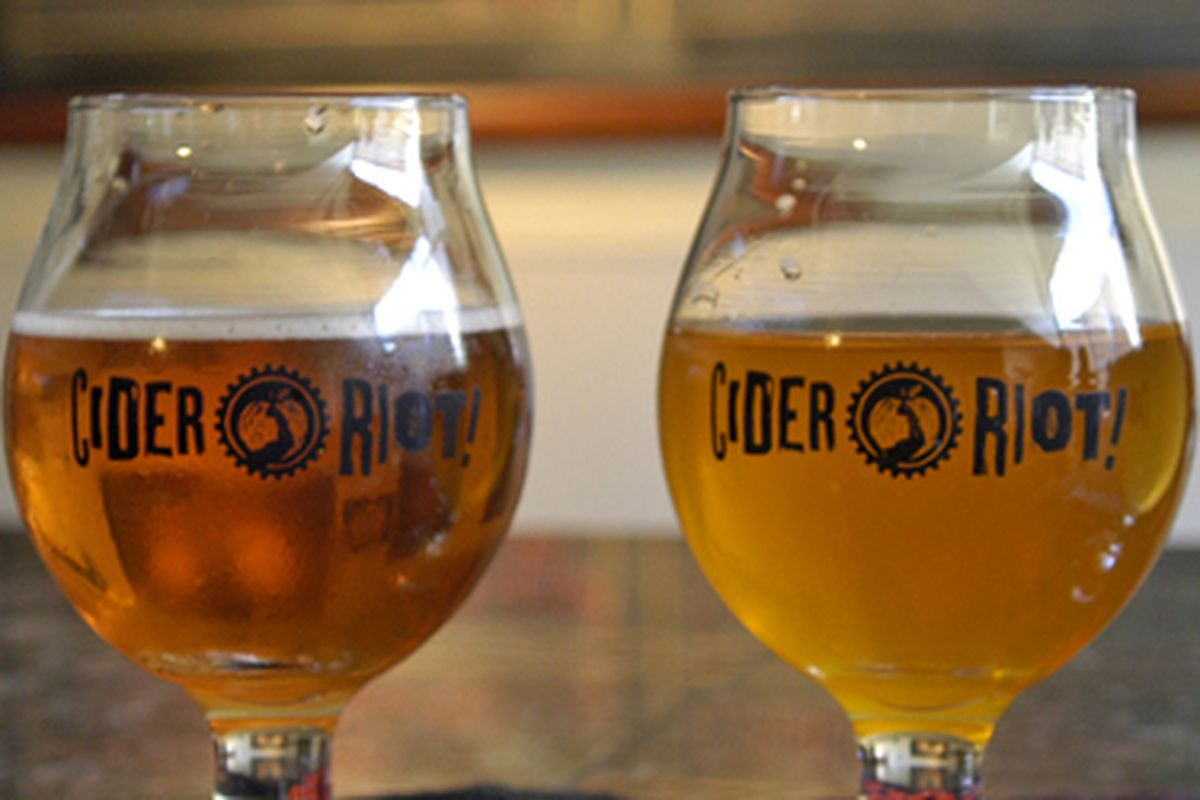 A picture of two glasses of amber cider at Cider Riot