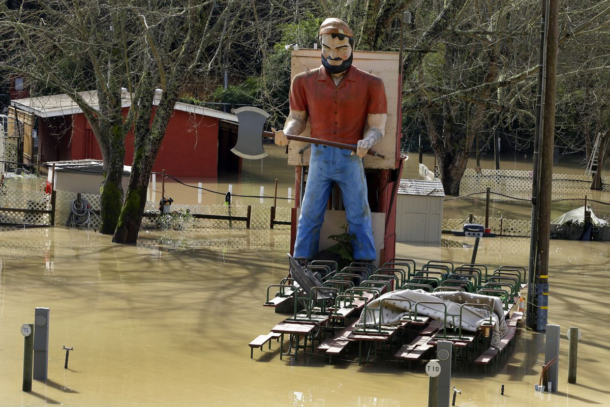 Part of the River Bend recreation area are submerged under floodwater Friday, Feb. 10, 2017, near Guerneville, Calif. The Russian River rose above its flood stage again on Friday due to excessive rain in the area causing minor flooding. (AP Photo/Ben Marg