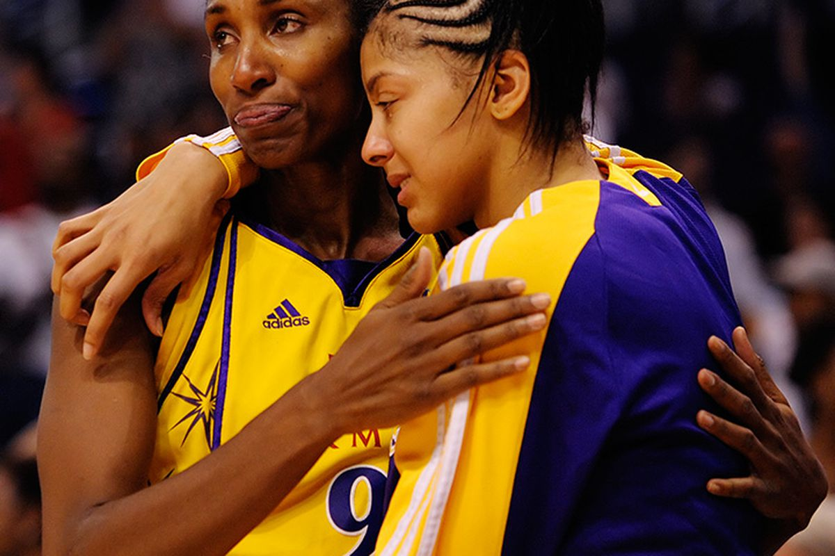 LA Sparks Candace Parker and Lisa Leslie embrace after losing the Western Conference Championship to the Phoenix Mercury.<em> September 26, 2009. Photo by Max Simbron</em>