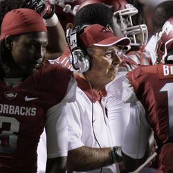 In this photo taken Sept. 8, 2012, Arkansas coach John L. Smith, center, meets with safetys Defonta Lowe (3), Eric Bennett and the rest of the team during a time out in an NCAA college football game against Louisiana Monroe in Little Rock, Ark. After a 34-31 overtime loss to the Warhawks, the pressure is on Smith as the suddenly unranked Razorbacks prepare for No. 1 Alabama on Saturday, Sept. 15.