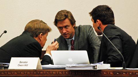 Johnston (center) huddles with Sens. Mark Scheffel (left) and Owen Hill after a vote went in an unexpected direction.