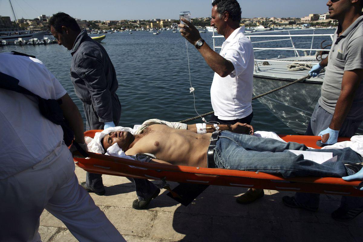 lampedusa migrant on stretcher