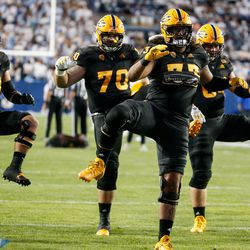 Arizona State players warm up ahead of an NCAA college football game against BYU at LaVell Edwards Stadium in Provo on Saturday, Sept. 18, 2021.