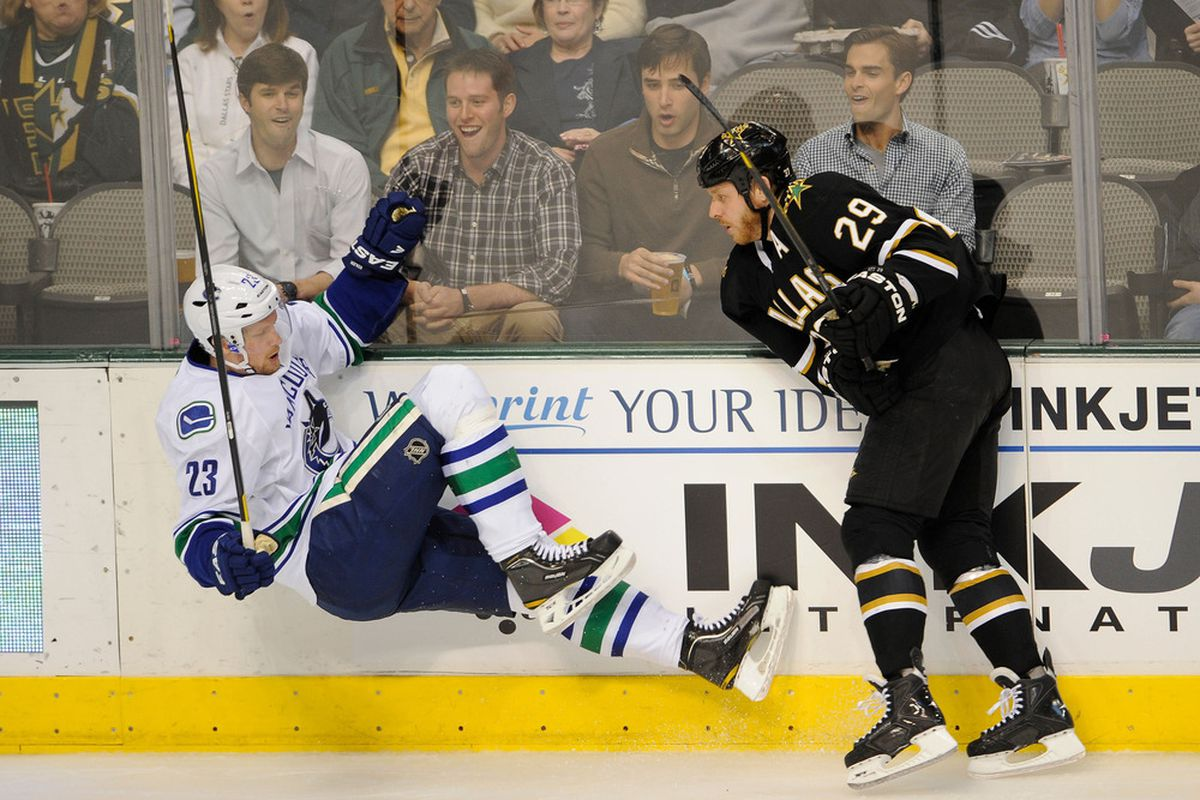 Mar 22, 2012; Dallas, TX, USA; Dallas Stars center Steve Ott (29) checks Vancouver Canucks defenseman Alexander Edler (23)  during the first period at the American Airlines Center. Mandatory Credit: Jerome Miron-US PRESSWIRE