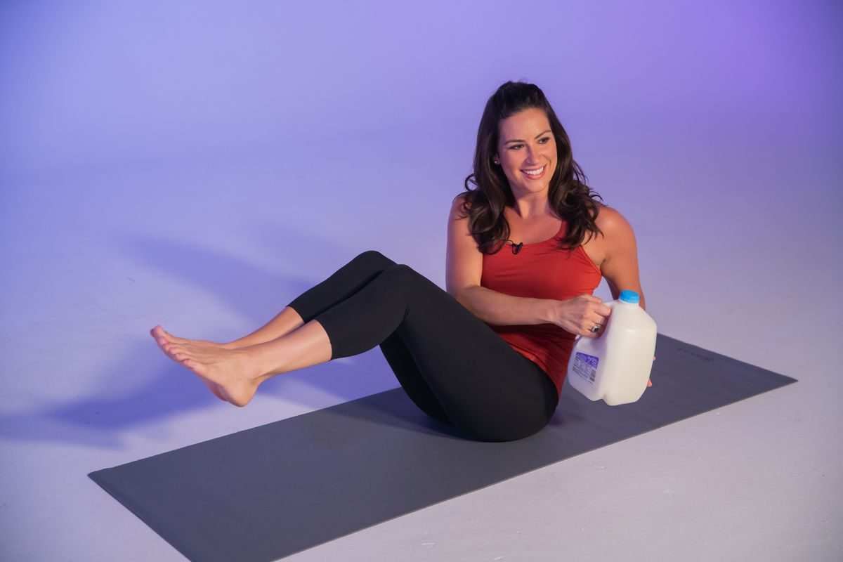 Here's how to use gallon of milk as a weight during a seated ab twist.