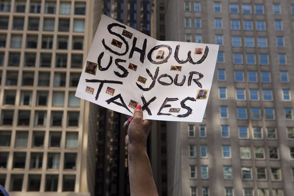 """A sign saying """"Show Us Your Taxes"""" from a march asking President Donald Trump to release his income tax returns."""