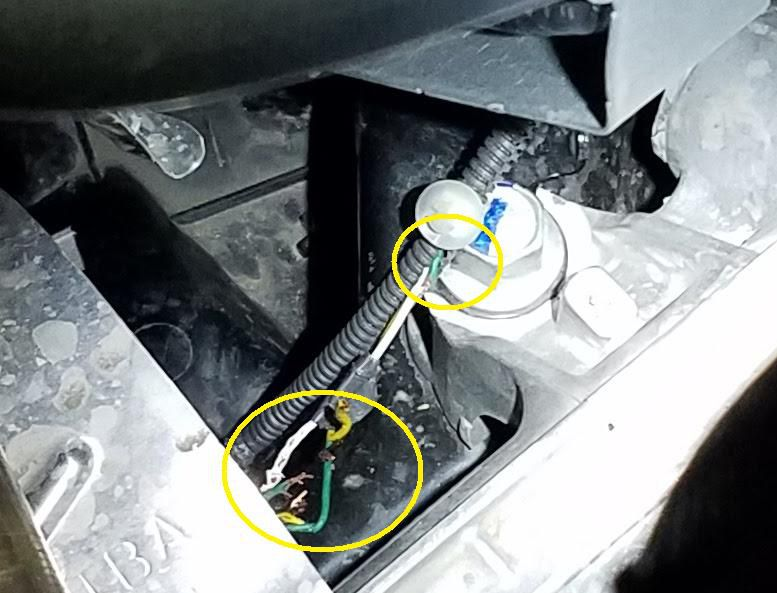 An example of rodent damage to a vehicle. The photo shows the inside of a vehicle engine; two areas with chewed wires are circled.