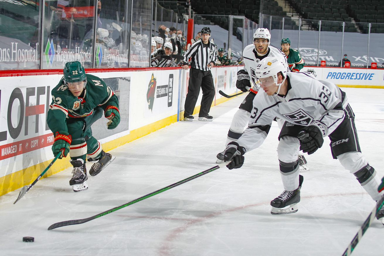 Kevin Fiala #22 of the Minnesota Wild and Tobias Bjornfot #33 of the Los Angeles Kings skate to the puck during the game at the Xcel Energy Center on February 26, 2021 in Saint Paul, Minnesota.