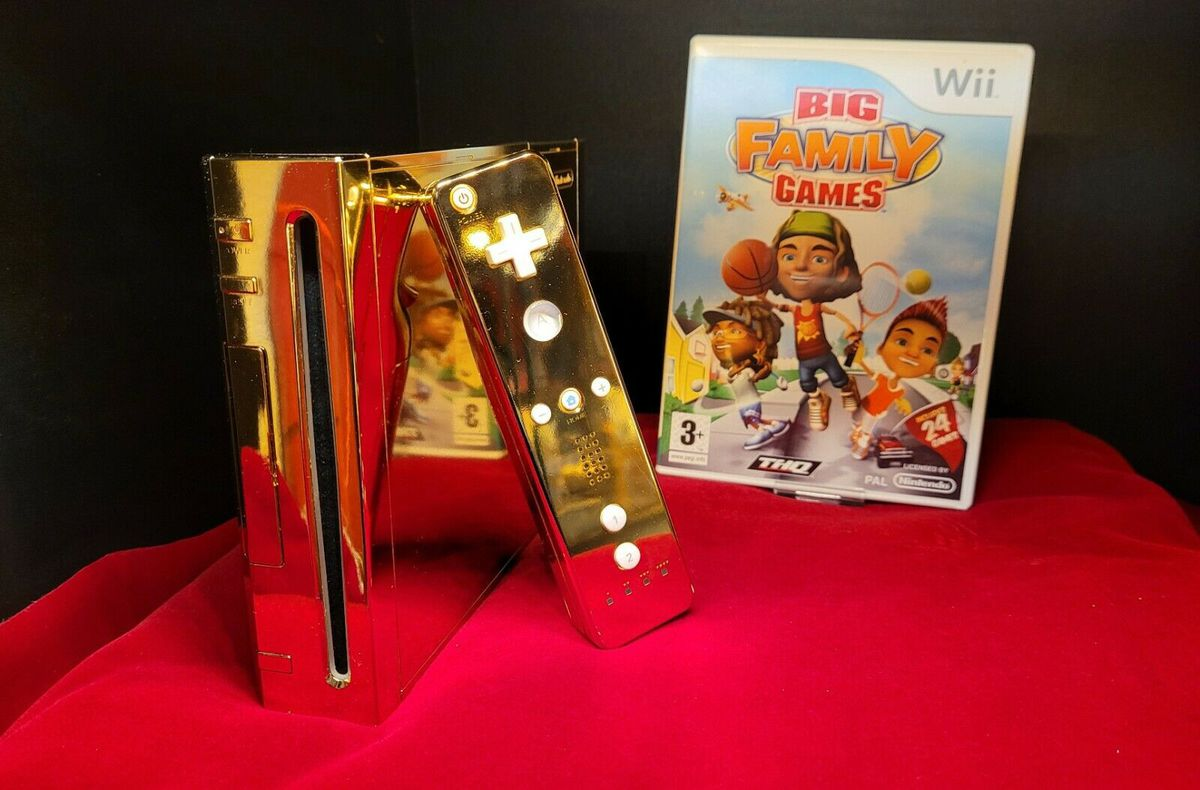 """eBay listing shot for the sale of a """"golden Wii"""" collectors item, showing the gold plated Nintendo Console with a case for the game Big Family Games"""