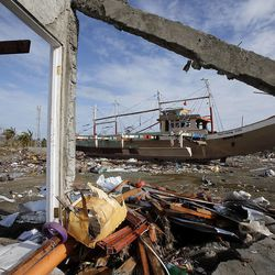 A boat is stranded on high ground in Tacloban, Friday, Nov. 22, 2013 following a typhoon.