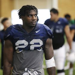Brigham Young Cougars running back Squally Canada (22) walks off the field after an intersquad scrimmage in Provo on Friday, March 23, 2018.