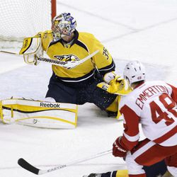 Detroit Red Wings center Cory Emmerton (48) scores against Nashville Predators goalie Pekka Rinne (35), of Finland, in the first period of Game 2 of an NHL hockey Stanley Cup first-round playoff series, Friday, April 13, 2012, in Nashville, Tenn.