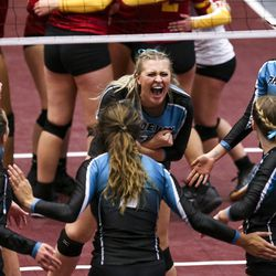Farmington middle hitter Kait White, back center, celebrates with her team following a point during the 5A high school state finals match at the UCCU Center on the Utah Valley University campus in Orem on Saturday, Nov. 9, 2019.