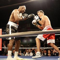 Former Massachusetts Gov. Mitt Romney, right, and Evander Holyfield fight during the Charity Vision Fight Night event in Salt Lake City, Friday, May 15, 2015.