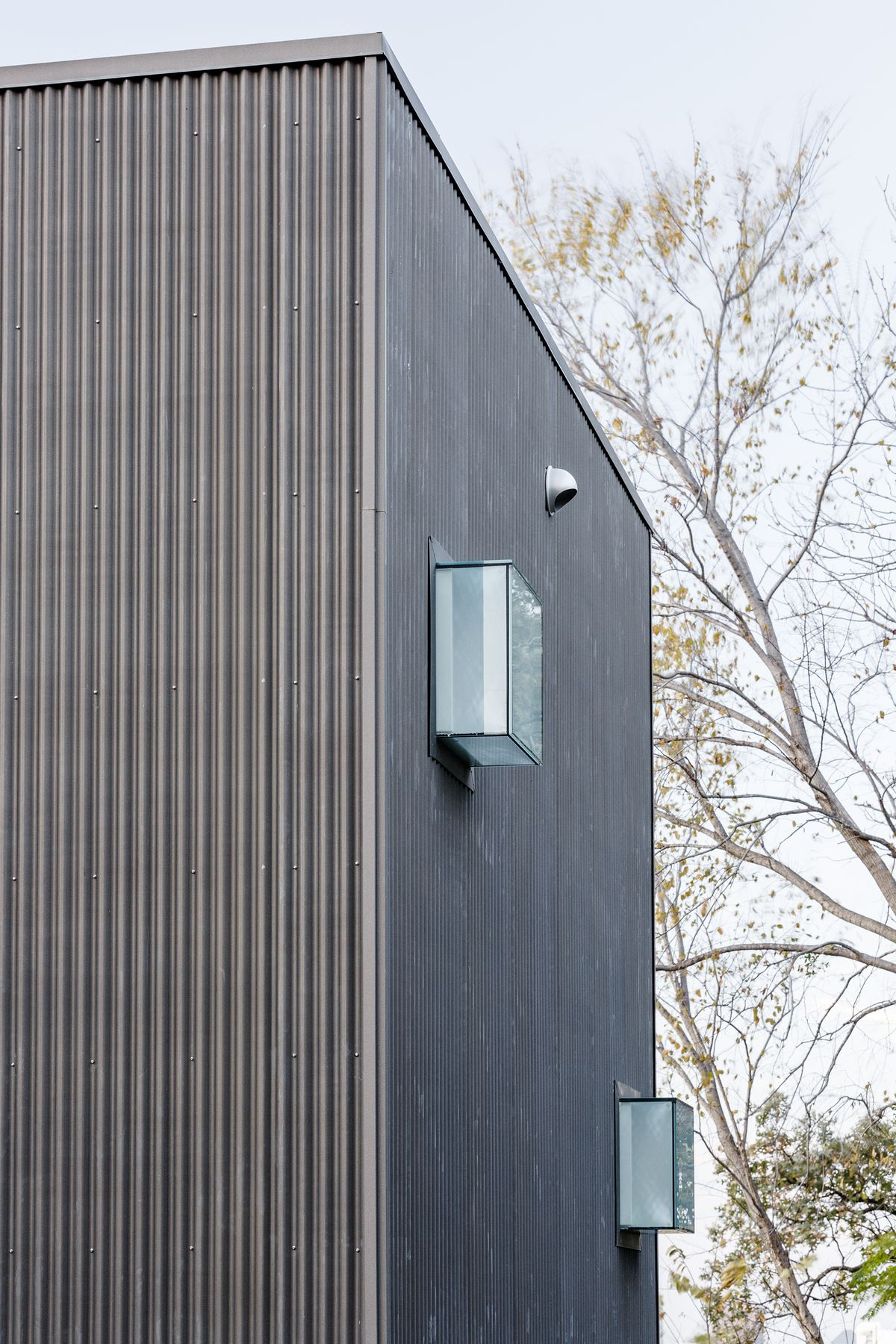 There are a series of small windows that, from the outside, look like glass boxes attached to the house.