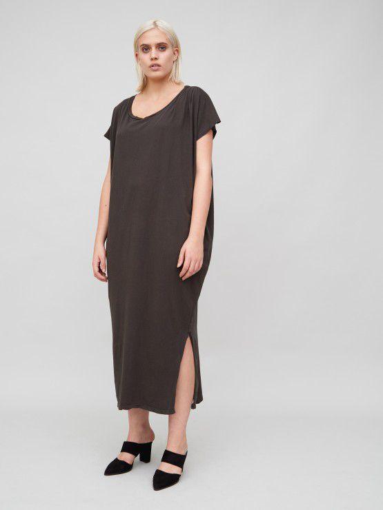 A model wears a cotton maxi T-shirt dress with a high side slit