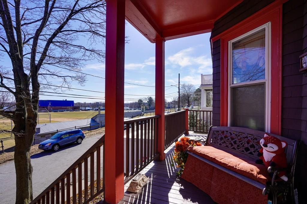 A front deck, narrow and with a small couch.