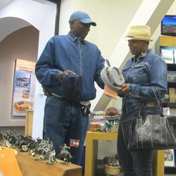 Durell Goode and Latonya Livingston of Atlanta, Ga., examine hats at the Fort Sumter tour boat dock facility in Charleston, S.C., on Friday, April 6, 2012. Visitation to the fort where the Civil War began reached a record 328,000 people during 2011 and visitation for the first three months of this year is again up over last year.