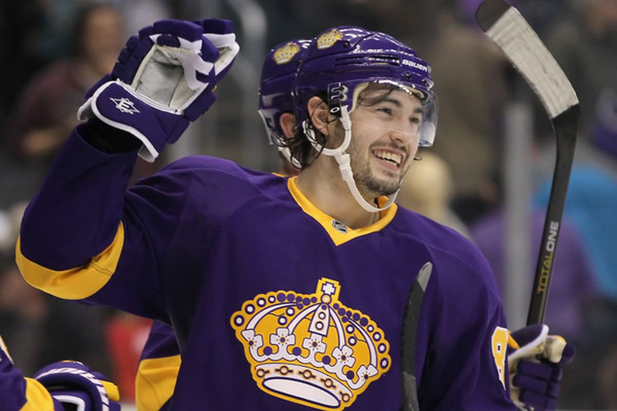 Doughty is the high bidder on Burns' sweater. No, not really, but look how happy he is, what else would it be?