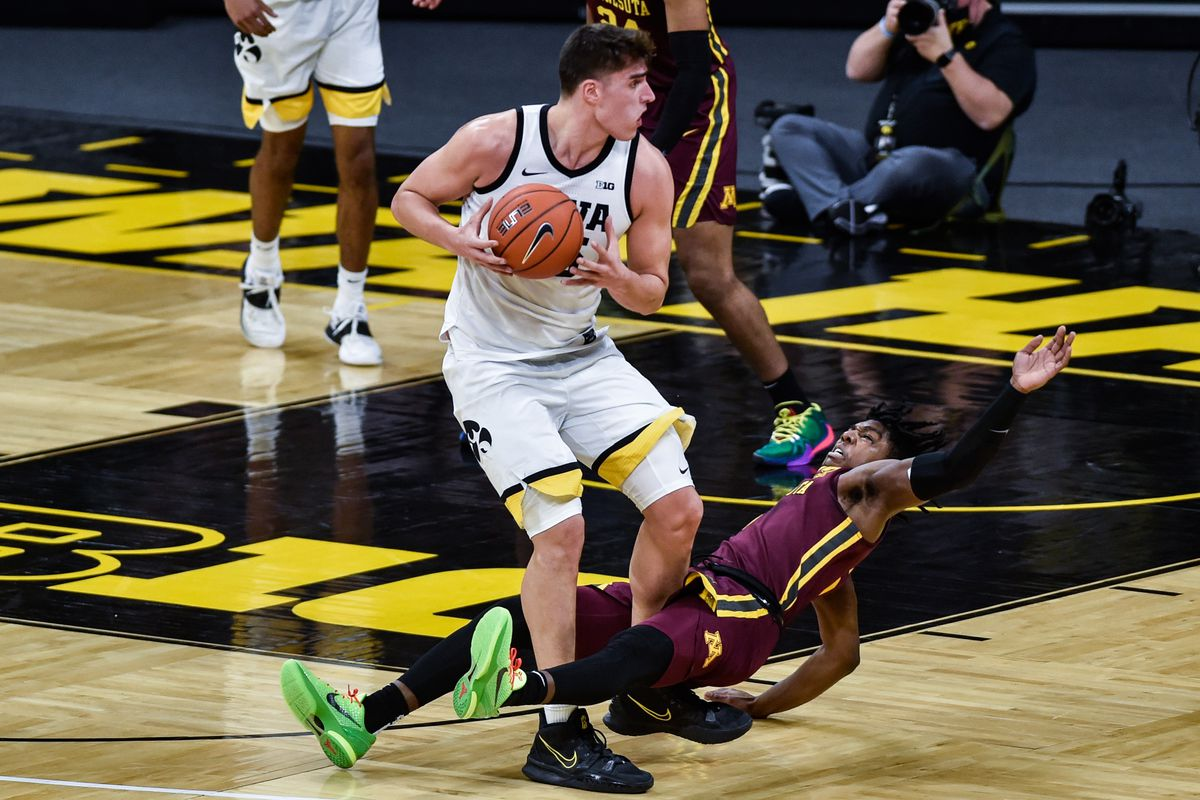 Minnesota Golden Gophers guard Marcus Carr draws a charging foul against Iowa Hawkeyes center Luka Garza during the first half at Carver-Hawkeye Arena.
