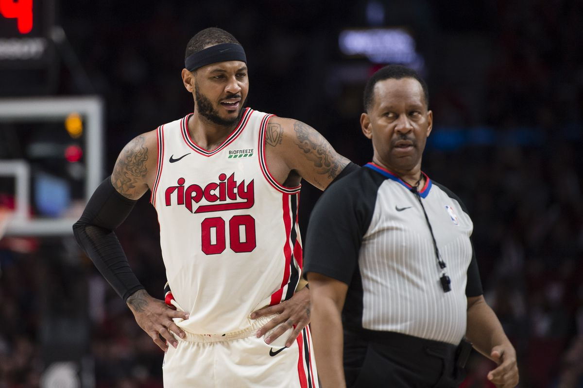 Portland Trail Blazers forward Carmelo Anthony questions an official during the second half against the Phoenix Suns at Moda Center. The Phoenix Suns won 122-116.
