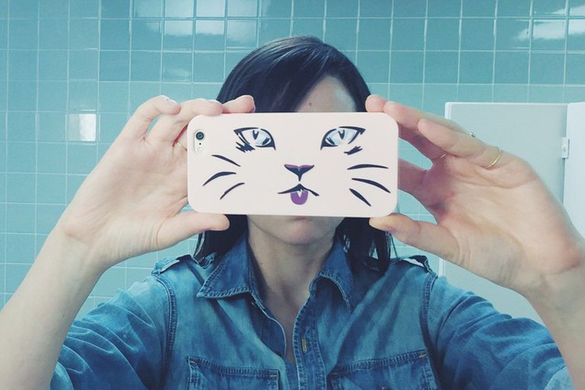 The author with her Aritzia cat iPhone case.