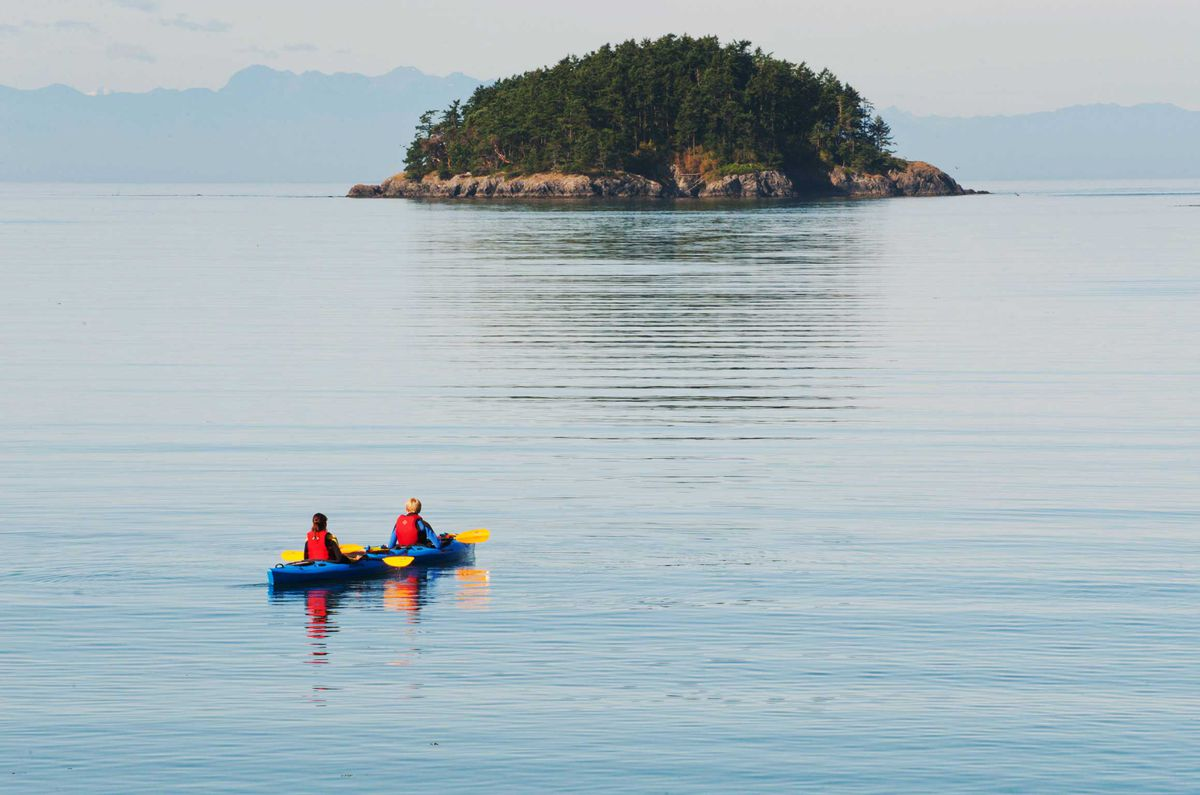 A kayak on the waters near Whidbey Island, an enclave not far from Seattle, Washington.
