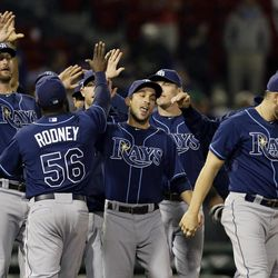 Tampa Bay Rays closer Fernando Rodney (56) celebrates with teammates after they defeated the Boston Red Sox 4-2 in a baseball game at Fenway Park in Boston, Wednesday, Sept. 26, 2012.