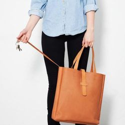 """Clean lines, supple leather and it fits comfortably around the shoulder. Possibly the perfect tote. <a href=""""http://www.shop.finelittleday.com/fashion/sandqvist-lisbet-black-1"""">Sandqvist Lisbet Tote</a>, $216 at Fine Little Day."""
